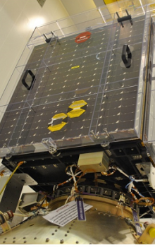 SATRAM engineering model (a) and the qualified flight model spacecraft payload attached to ESA's Proba-V satellite (b). SATRAM size: 55.5 mm (height), 62.1 mm (width) and 107.1 mm (length); mass including shielding box: 380 g.