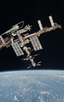 Photo of ISS and ATV with docked Endevour Shuttle made by ESA astronaut Paolo Nespoli.