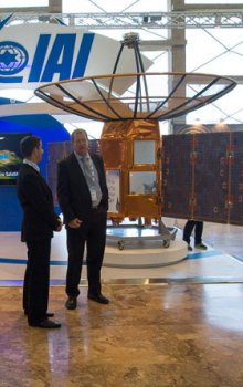 Booth of the leading Izraeli manufacturer of aerospace and space technique Israeli Aerospace Industries with the model of TECSAR satellite for radar remote sensing.