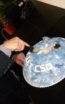 Cutting the anniversary cake.