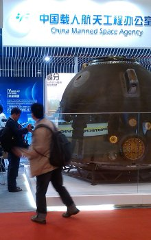 Booth of China Manned Space Agency with original flight model of lander of spaceship Šen-čou 10.