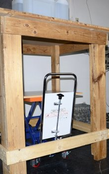 Image of station with a wooden contruction, where the target is placed. Under the construction, there is adjustable rack for the detector.